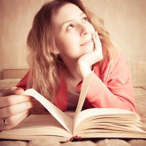 Bigstock_girl_dreams_reading_the_book_15369656_2