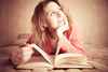 Bigstock_girl_dreams_reading_the_book_15369656_2